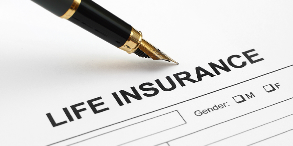 Close-up of a life insurance application with a pen on top